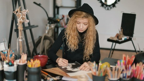 Graphic designer working in her studio
