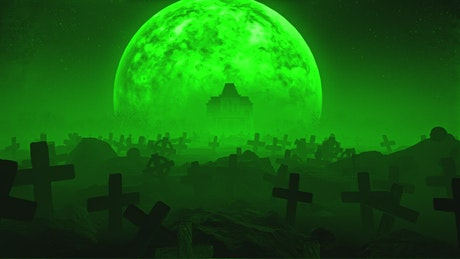 Graveyard under the moon with green mist