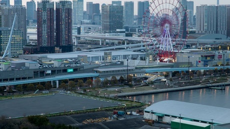 Great metropolis with a Ferris wheel as dusk
