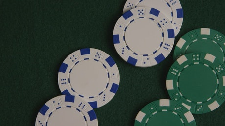 Green and white poker chips