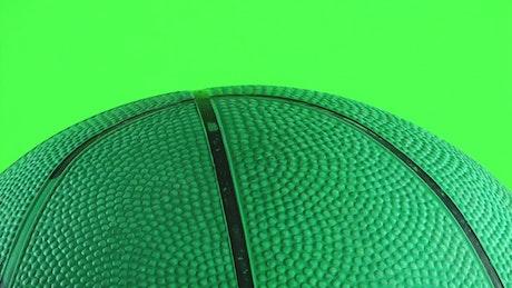 Green basketball on chroma key background