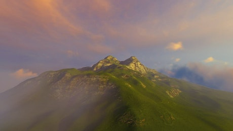 Green cloudy mountain in 3D from the air