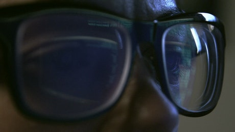 Green code reflecting on glasses
