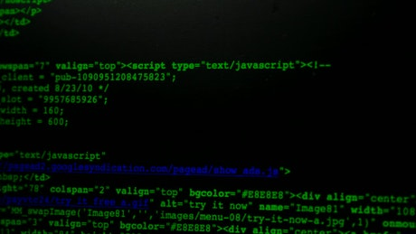 Green code scrolling on a monitor