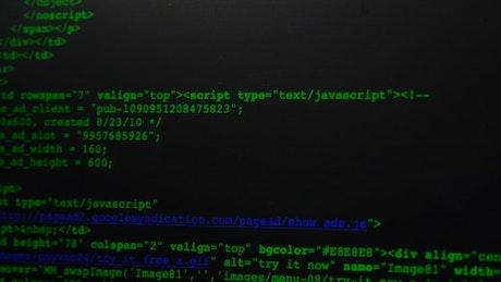 Green computer code scrolling