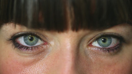 Green eyes of a woman, close up