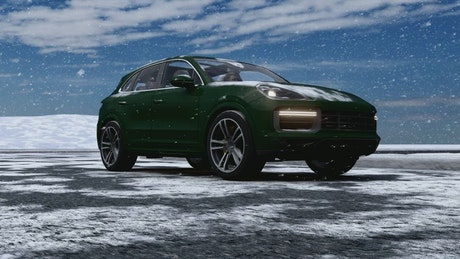 Green luxury vehicle in a snowy road