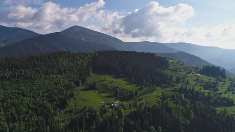 Green mountainous valley during a sunny summer