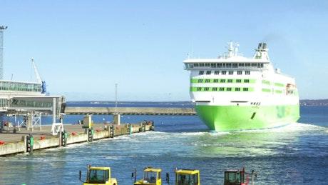 Green ship leaving port