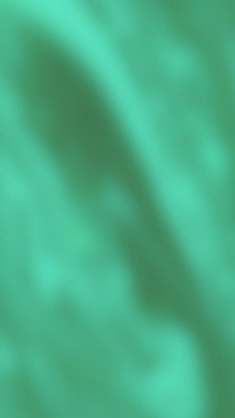 Green silk blurred texture