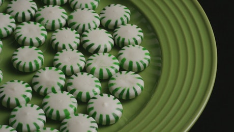 Greens spermints on a green plate rotating