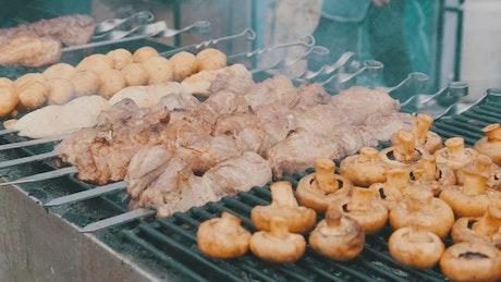 Grilled meat and mushroom skewers