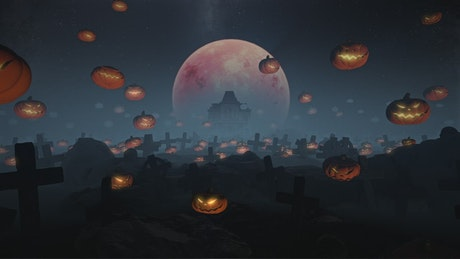 Grim graveyard with pumpkins and the full moon