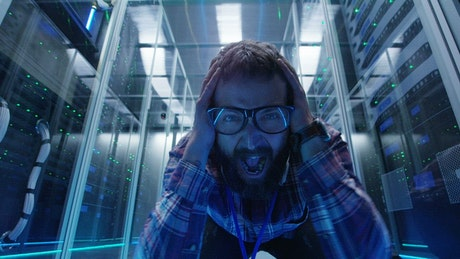 Grimacing IT engineer in the server room