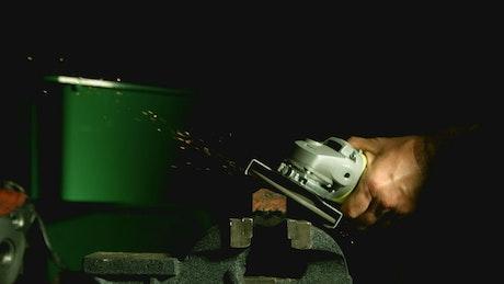Grinder tool creating sparks in the darkroom