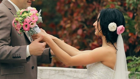 Groom and bride kiss after their wedding party