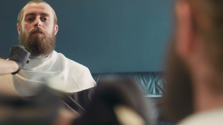 Grooming a man's beard
