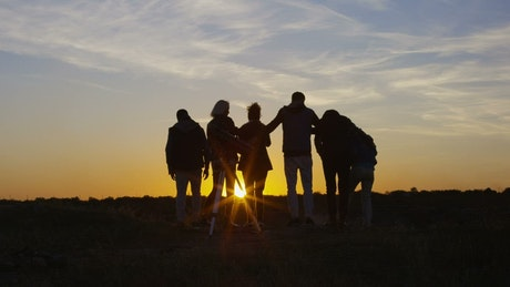 Group of friends watching the sunset together