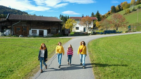 Group of girls walking down the road in the alps