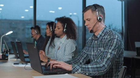 Group of people working on a call center