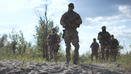 Group of soldiers walking in the battlefield