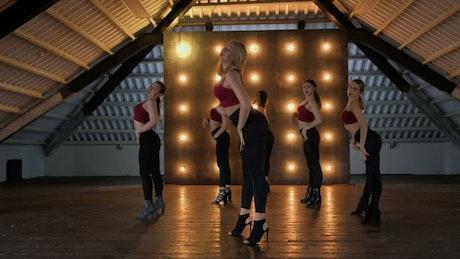 Group of women doing Zumba in attic studio