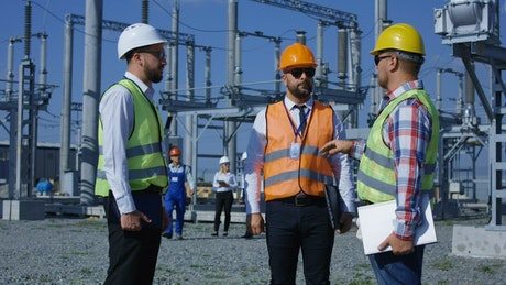 Group of workers in an electrical plant