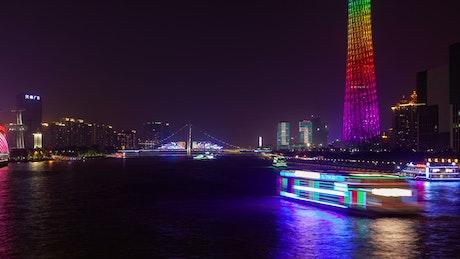 Guangzhou illuminated cityscape and river traffic