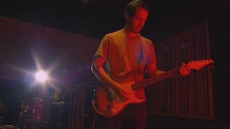 Guitarist enjoying playing his guitar