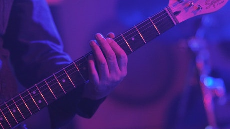 Guitarist playing an electric guitar on stage
