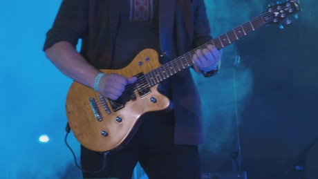 Guitarist playing at a concert