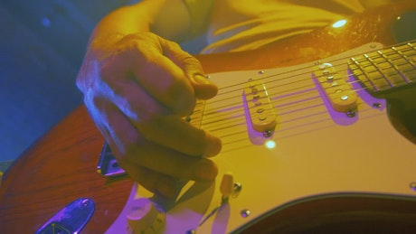 Guitarist plays and moves his electric guitar