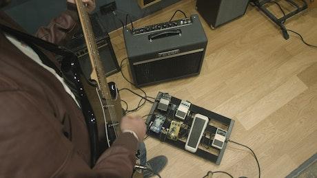 Guitarist practicing in a recording studio