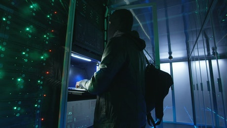 Hacker introducing malware to data center