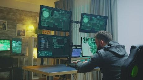 Hacker raising his hands in success