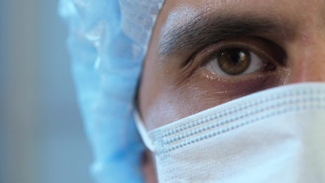 Half face of a doctor wearing mask