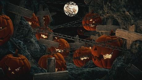 Halloween pumpkins in a graveyard on a full moon