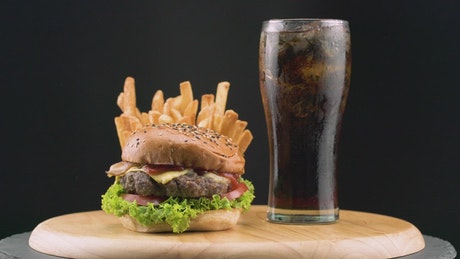 Hamburger with French fries and soda