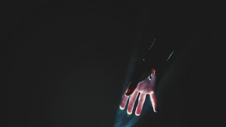 Hand of a person around a light source