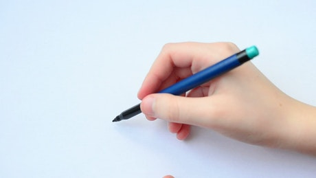 Hand of a young person drawing a family