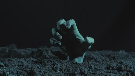 Hand of a zombie coming out of the ground