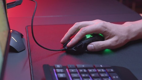 Hand using a gaming a neon lights mouse