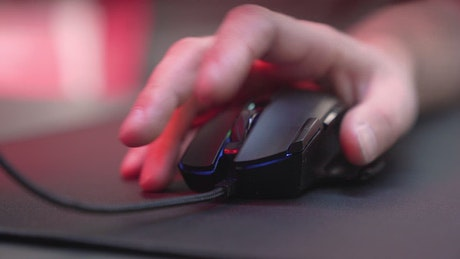 Hand using a gaming mouse