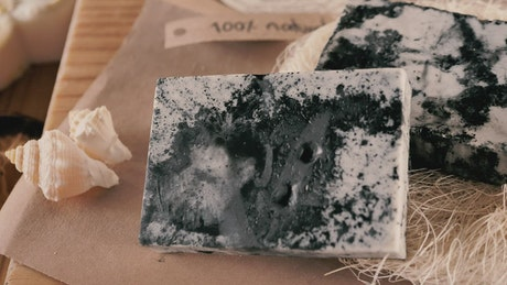 Handmade black and white soaps on the table