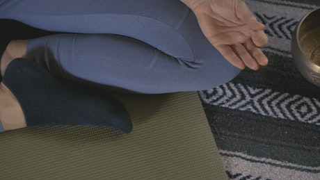 Hands and legs of a woman when meditating in yoga pose
