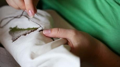 Hands doing needlework