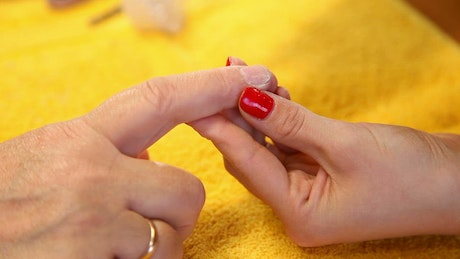 Hands getting manicure