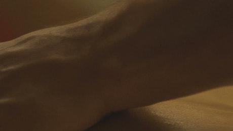 Hands massaging a woman's back