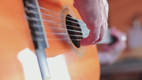 Hands of a person playing the guitar