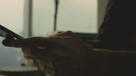 Hands shown texting on a smartphone